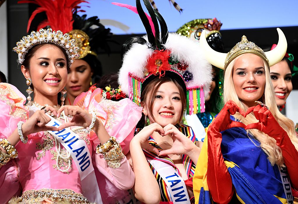 Miss Thailand Pattiya Pongthai (L), Miss Taiwan Tan Ai-Ning (C) and Miss Sweden Maria Taipaleenmaki pose during a photo session of the opening press preview of 2016 Miss International Beauty Pageant in Tokyo on October 11, 2016. Seventy women will compete in the final in Tokyo on October 27. / AFP / TOSHIFUMI KITAMURA (Photo credit should read TOSHIFUMI KITAMURA/AFP/Getty Images)