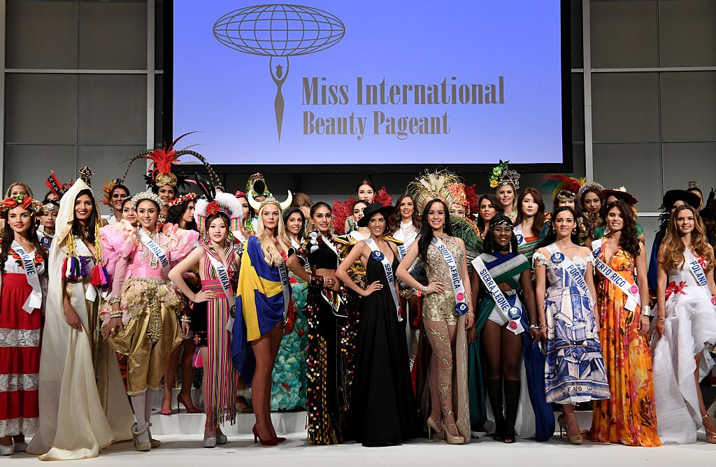Contestants pose during a photo session of the opening press preview of 2016 Miss International Beauty Pageant in Tokyo on October 11, 2016. Seventy women will compete in the final in Tokyo on October 27. / AFP / TOSHIFUMI KITAMURA (Photo credit should read TOSHIFUMI KITAMURA/AFP/Getty Images)