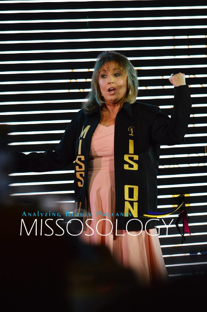"""Miss Universe Organization president Paula Shugart reacts after receiving a jacket with the words """"Miss U is on"""" at the 65th Miss Universe kick-off event held December 11 at S Maison in Conrad Hotel, Pasay City. (Missosology.Org)"""