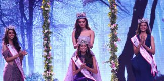 Anukreethy Vas (center) is crowned by Manushi Chhillar